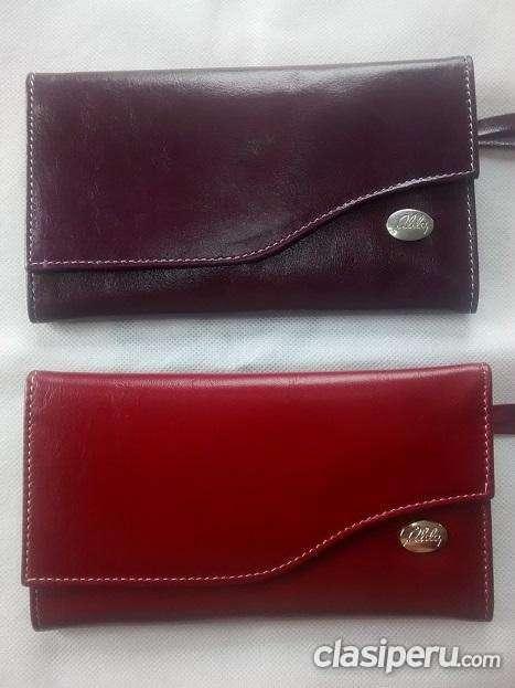 Apurado vendo billetera de cuero de dama larga marca alda a precio bajo